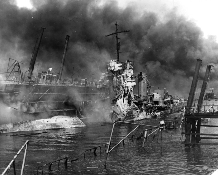 The USS Shaw, a Navy destroyer, wreck in a floating drydock. After the ship was set afire by Japanese dive-bombing attacks, the ship's bow was blown off by the explosion of its forward magazines.