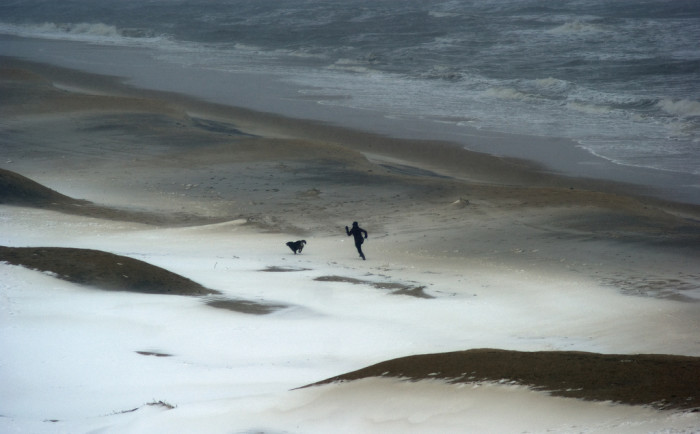 8. The snow transforms the sand at Virginia Beach is this hauntingly beautiful image.