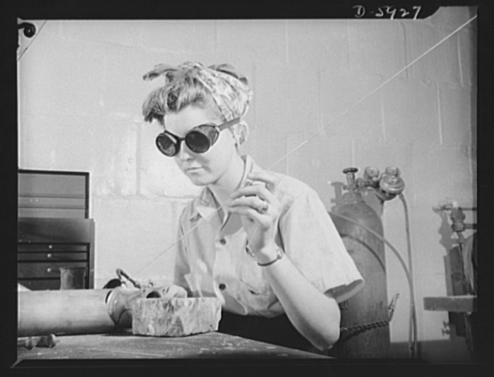 21. Eighteen-year old Evelyn Spangler works as a welder and repairwoman as part of the repair crew at Washington National Airport in Arlington, August 1942.