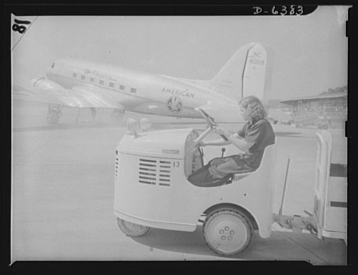 """22. Formerly a seamstress in a laundry, Mattie Marks drives a """"gas buggy"""" to transport baggage from the Washington National Airport baggage room to the planes, August 1942."""