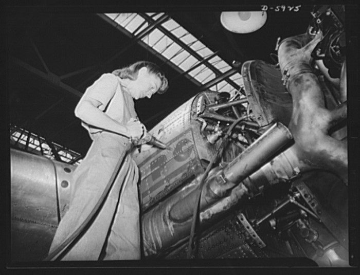 20. Mrs. Marjorie Landa, daughter of the late Congressman Frank Mandell of Wyoming, makes repairs on the engine of a Pennsylvania Central Airlines DC-3 transport plane at Washington National Airport in Arlington, August 1942.