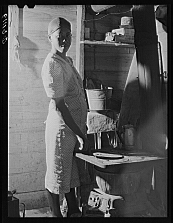 1) Wife of migrant fruit picker. They live in a one-room windowless shack on property of grower Berrien County, July 1940.
