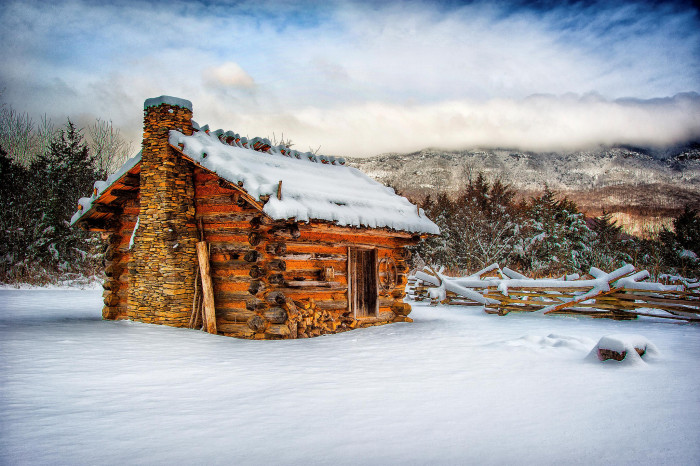 2. A blanket of snow surrounds this cabin at Wilderness Road State Park in Ewing.
