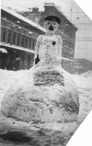 """2. This snowman, who is donning a police hat and star badge while holding a whiskey bottle, displays a sign reading, """"It's a privilege to live in Colorado."""""""