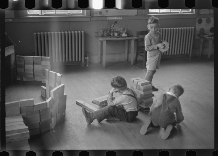 2. These school boys are playing with blocks during a free period at a school in Reedsville, 1936.