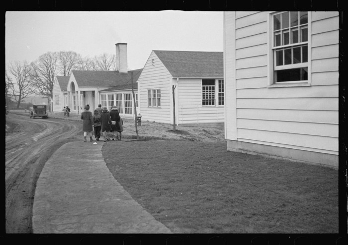 11. Here are some children leaving a schoolhouse in Reedsville, 1936.