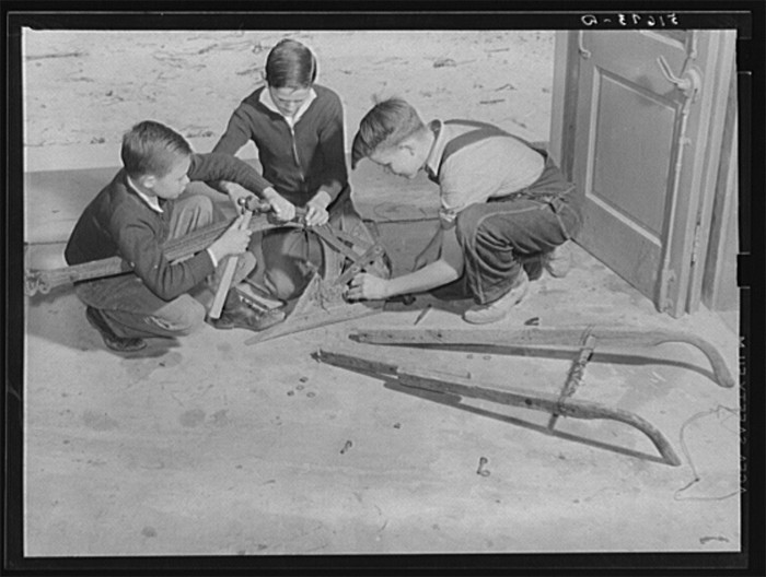 1. Children repairing a plow in shop class at Ashwood Plantation in Lee County.