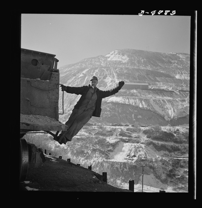 6. The brakeman on an ore train at Bingham Canyon Mine.