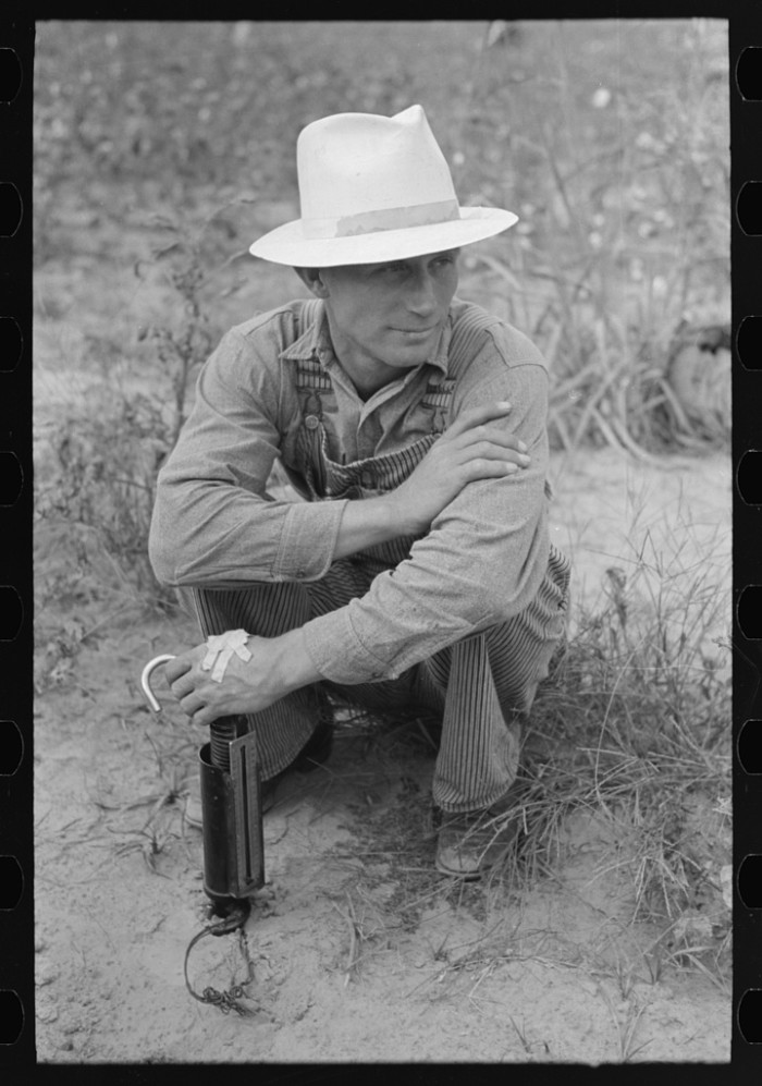 10. Farmer With Cotton Scale