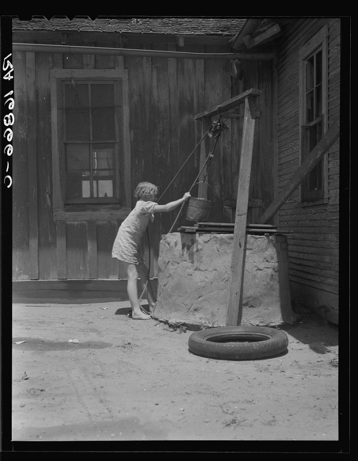11. This sharecropper's child in Hall is one of ten. Everyone had to lend a helping hand, even the little ones. June 1937.