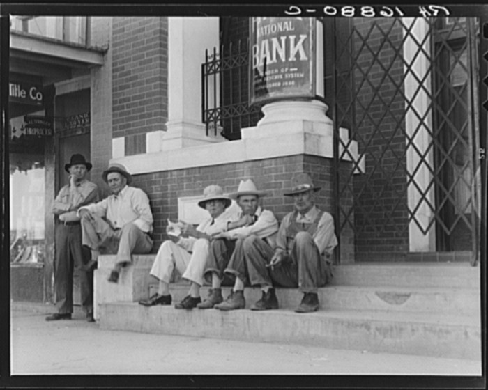 13. Banks were barred shut, but people still gathered in front of them remembering days of economic prosperity. June 1938.