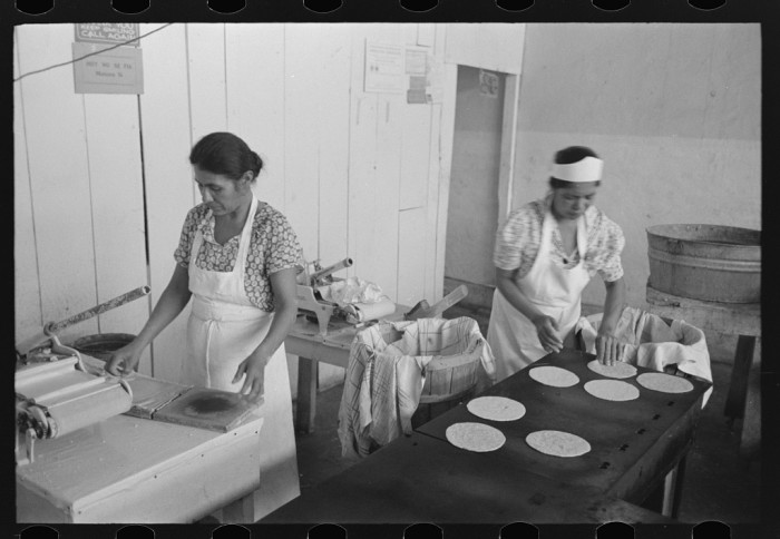 2. A family made tortillas to give to pecan shellers in exchange for a share of their crop. 1939.