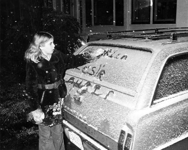 Laurie Dughi writing in the snow