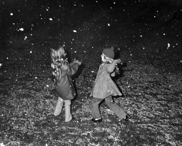 Liz Minerva, left, playing in the snow with Leslie Dughi