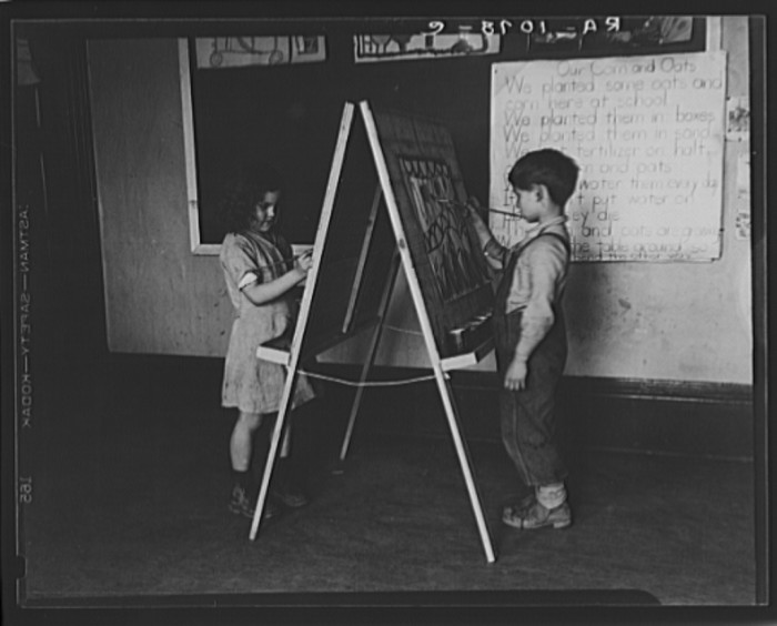 16. Here are two first-grade students drawing at a school in Reedsville, 1935.