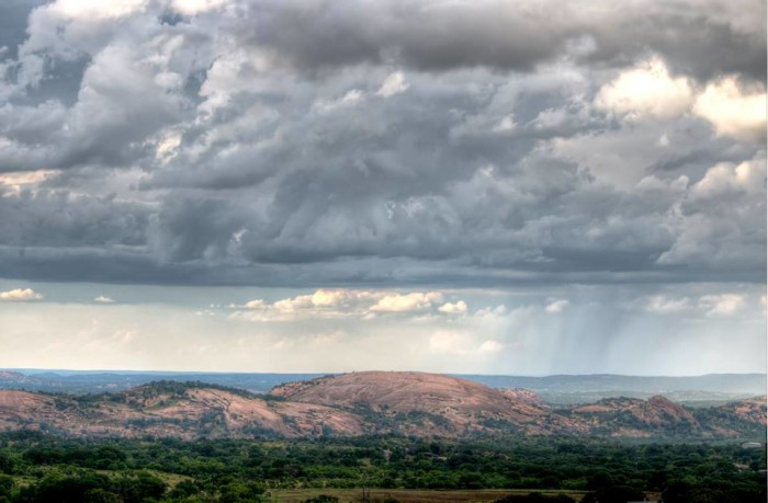4. Andy Harris sent us this unique shot of a storm moving through Enchanted Rock.