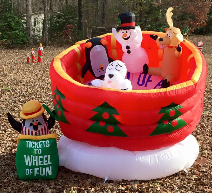 5. The inflatables in this Christmas display make this one as fun during the day as it is at night.