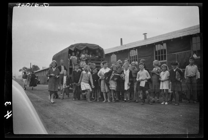 15. These children were transported to their school in Eleanor on this truck, 1935.