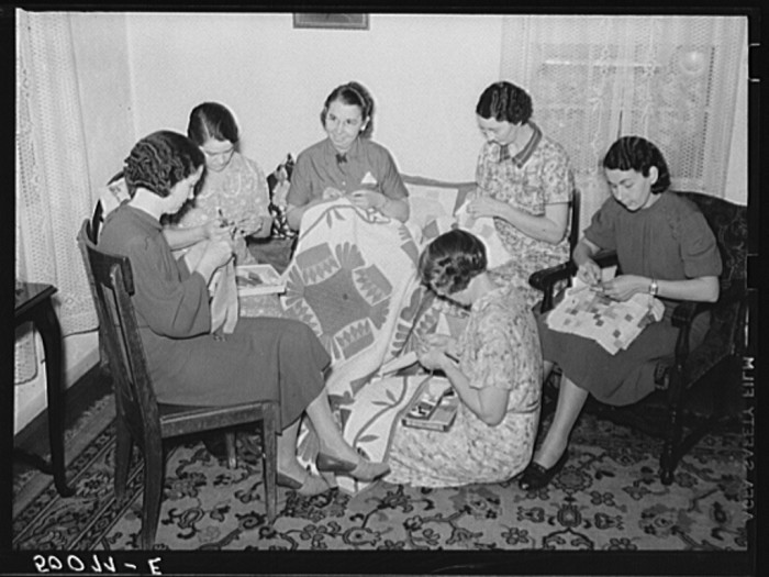 10. These housewives in Tygart Valley having a quilting meeting in September 1938.