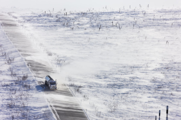 7) Blowing snow across the James Dalton Highway near Finger Mountain.