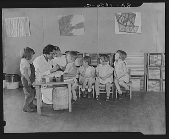 6. A nurse tends to school children in Reedsville.