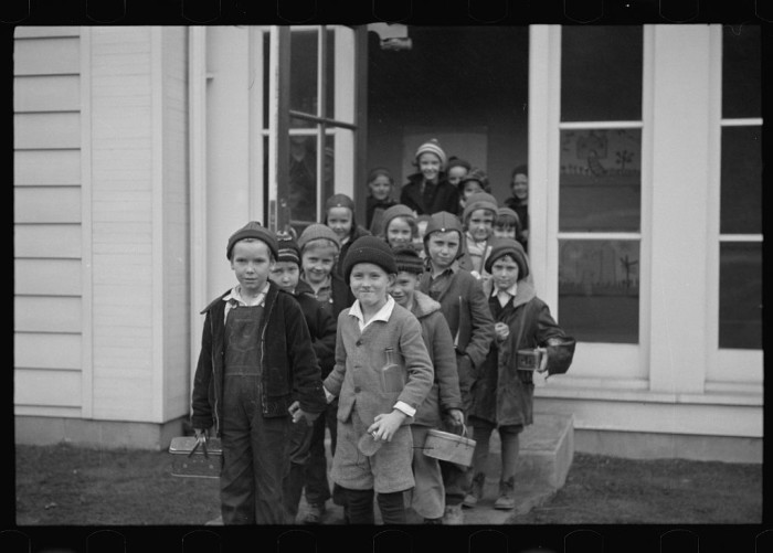 12. These kids are leaving school in Reedsville, 1936.