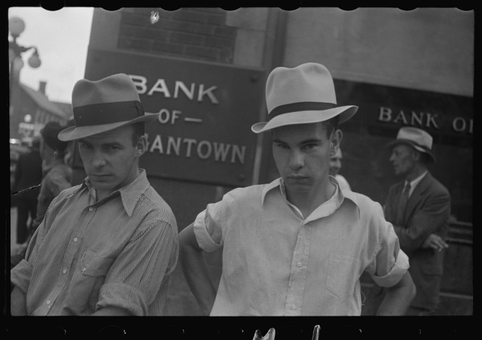 4. Here's a shot from Mainstreet in Morgantown. Notice the bank signs behind the men.