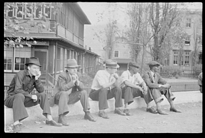 15. These men sitting on a curb in Omar in October 1935.