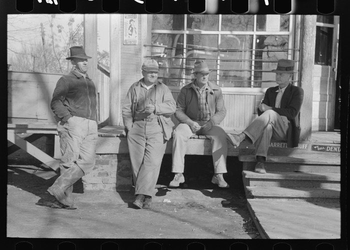 17. Men Outside General Store