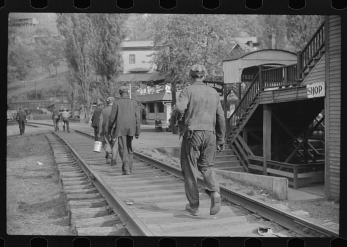 7. These miners are going home from work in Omar, September 1938.