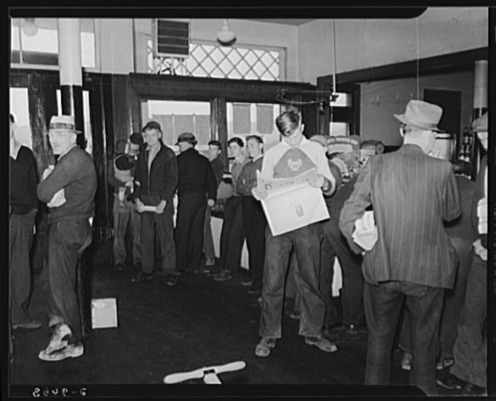 10. These miners are hanging around a company store in Kempton during a strike in 1939.