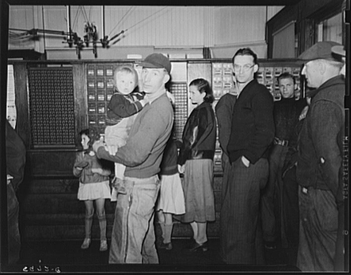 1. These miners are waiting on their mail at the post office in Kempton in 1939.