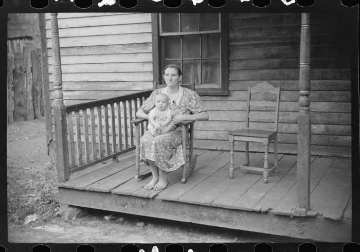 11. This coal miner's wife with her baby on a porch in Mohegan in September 1938.