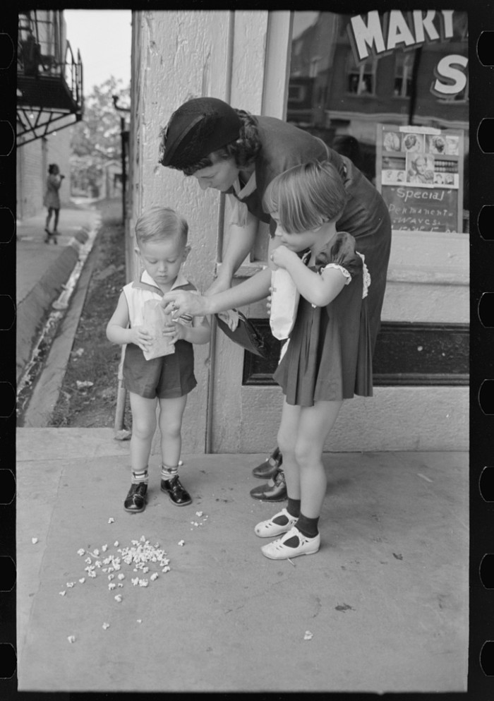 11. Mother with two children with popcorn, National Rice Festival, Crowley, Louisiana