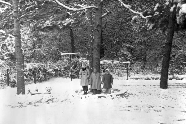 Children standing in a winter wonderland at Indian Head Acres