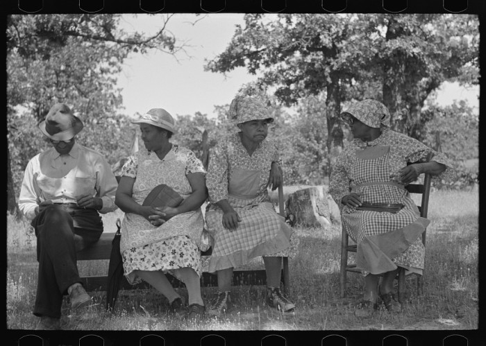 10. A family waiting outside a rural church while other members of their families are attending a church business meeting, taken in McIntosh County in 1939.