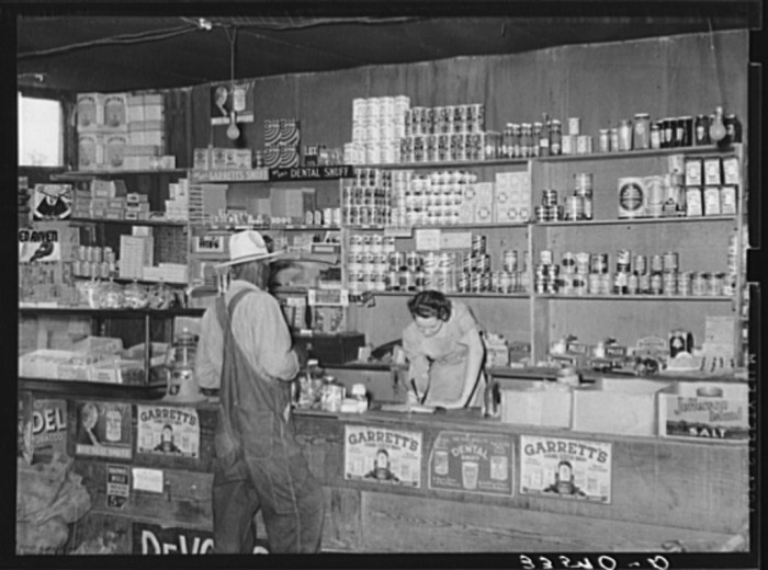 5. A customer purchasing items at a country store in 1939 in Wagoner County,