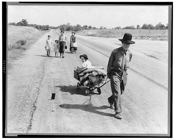 20. This family of 7 is walking on a highway in Pittsburgh County, Oklahoma. They started from Idabel, Oklahoma and are bound for Krebs, Oklahoma. The father was a farmer but got ill with pneumonia and lost the farm.