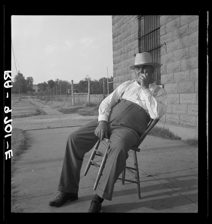 6. The sheriff sitting in front of the McAlester jail in 1936. He had been the sheriff for 30 years.