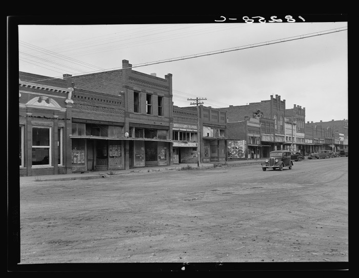 9. The depression and drought struck towns as well as farms. Laborers, clerks and building tradesmen immigrated, as well as farm people. This town was Caddo in 1938.