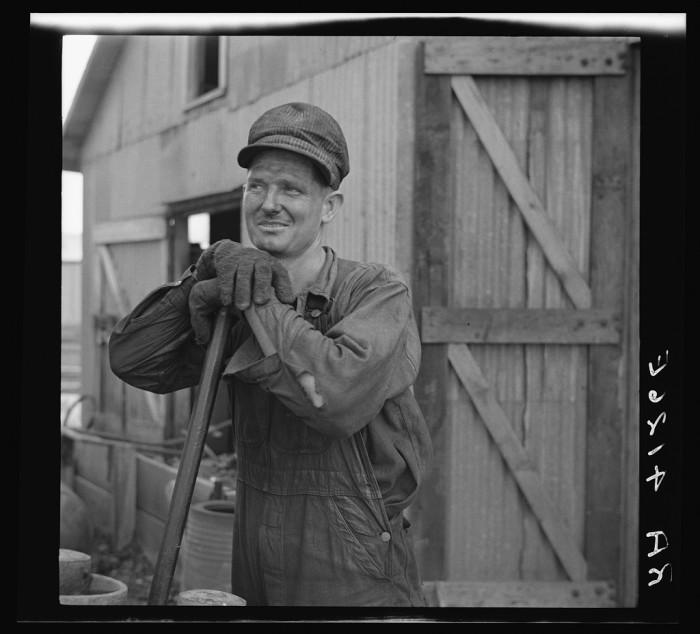 21 . A zinc smelter worker in Picher, OK in 1936.