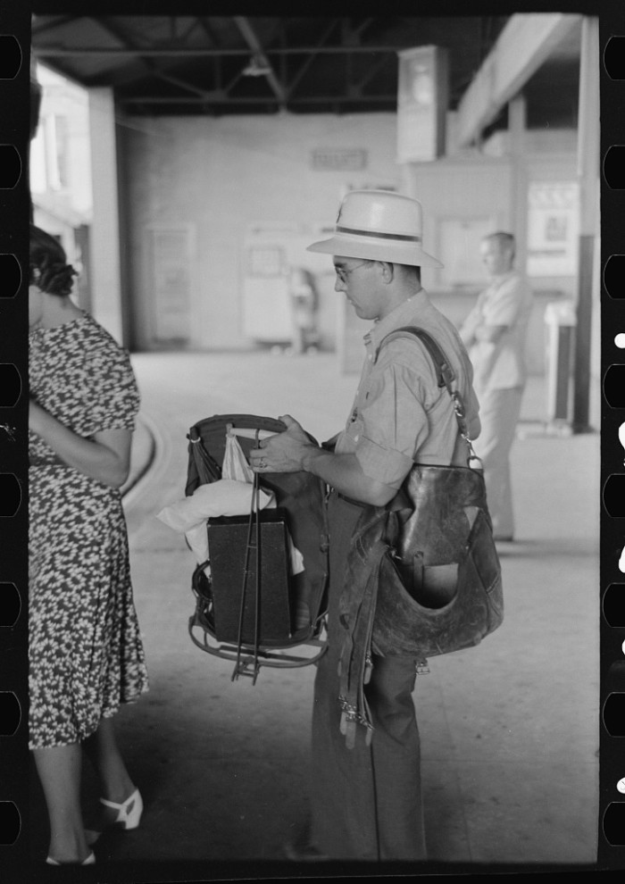 "16. ""Postman with equipment waiting to board. Streetcar terminal, Oklahoma City, Oklahoma."""