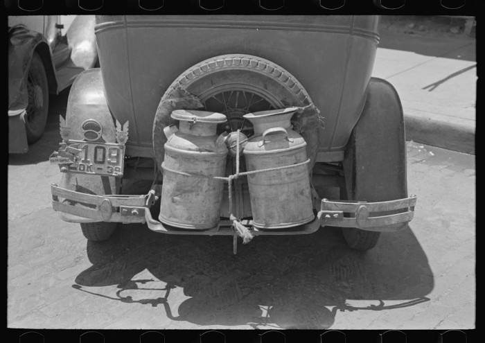 "4. ""Milk cans tied on back of farm automobile, Muskogee, Oklahoma."""