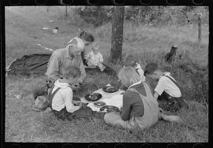 "12. ""White migrant family saying grace before noonday meal by the side of the road east of Fort Gibson, Muskogee County, Oklahoma."""