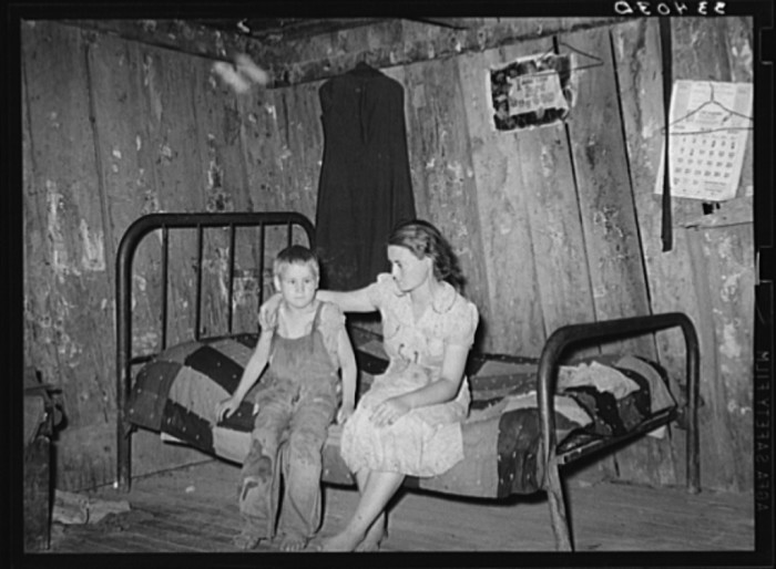 "13. ""Daughter and son of agricultural day laborer living near Webbers Falls, Oklahoma. The furnishings of this shack were meager and broken and filthy."""