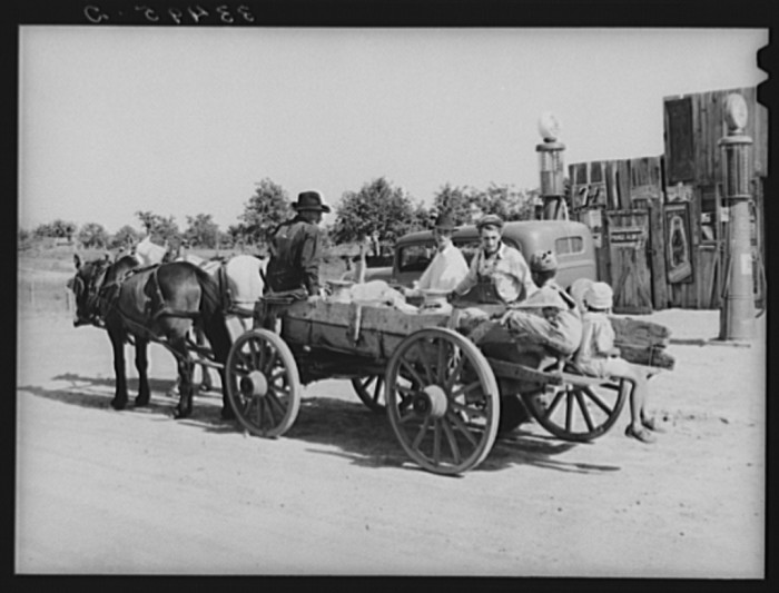 "14. ""Farmer's wagon loaded with supplies leaving crossroads store in McIntosh County, Oklahoma."""