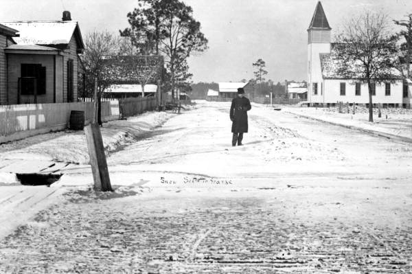 Mayor A.L. VonKern standing on snow covering street