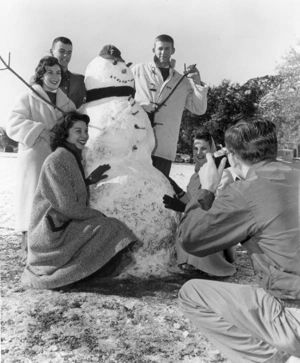Florida State University students gathered around their snowman for a portrait.