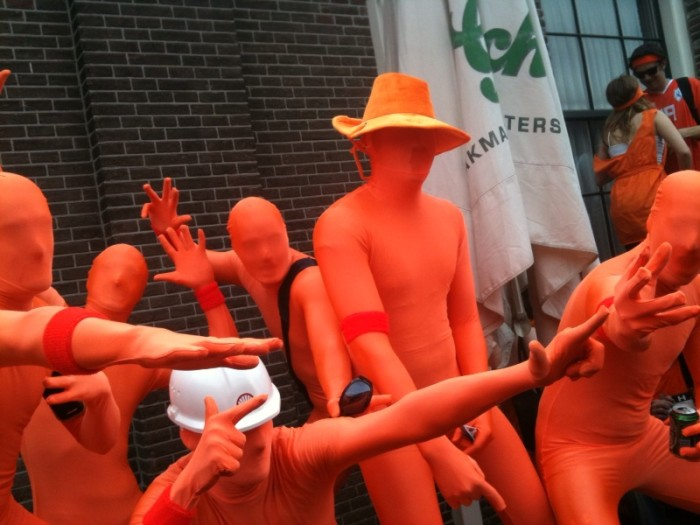 10. Men in red suits baffled passersby.