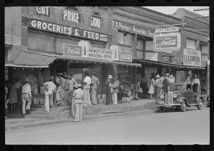 Everyone was social in the East Texas old days. This street is lined with people out and about and enjoying their day.